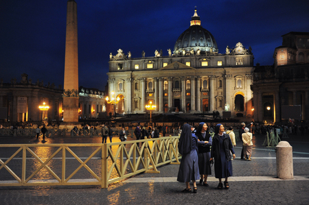 catholic nuns: VATICAN - APR 29:Saint Peters Basilica at night on April 29 2011 Vatican city, Rome Italy.Its the most renowned work of Renaissance architecture and remains one of the largest churches in the world.
