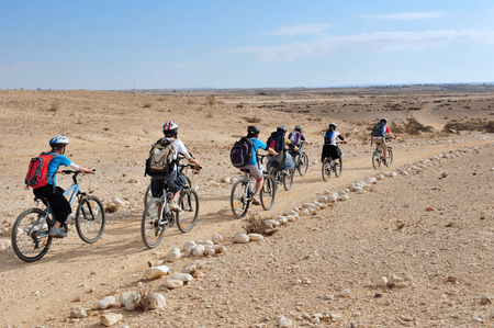 israelis: NEGEV,ISR - MAY 31:People cycle over the wilderness of the Negev Desert on May 31 2009.Various peoples have lived in the Negev since the dawn of history such as:Nomads, Canaanites, Nabateans and Israelis. Editorial