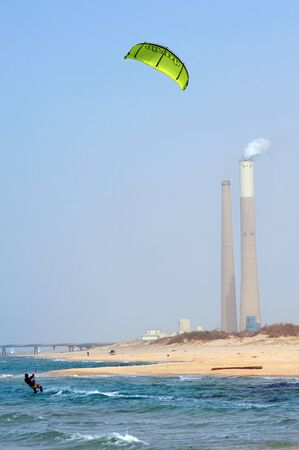estimated: ASHKELON - JAN 29: Kitesurfer is kite boarding on January 29 2011 in Ashkelon, Israel.In 2012, the number of kitesurfers estimated to 1.5 million persons world wide.