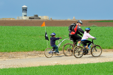 motorcars: WESTERN NEGEV - FEB 05: Unknown riders on November 06 2010 in the wester Negev,Israel.There are about a billion bicycles in the world, twice as many as motorcars.
