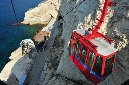 hanikra: ROSH HANIKRA,ISR - JAN 12:Cable car to Rosh HaNikra on January 01 2011.Its a geologic formation of a white chalk cliff with spectacular grottos located on the north coast of Israel.