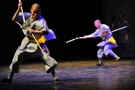affiliation: HENAN - JAN 13: Shaolin monks feature Kung Fu martial arts fight on January 13 2011 in Henan Province, China. It collection of Chinese martial arts that claim affiliation with the Shaolin Monastery.
