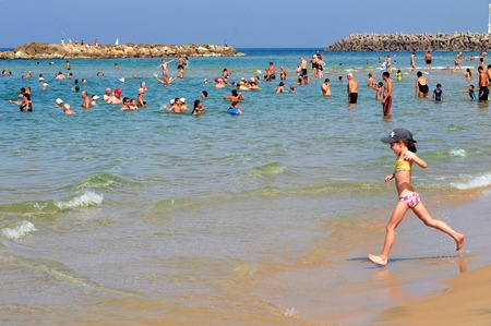 israelis: ASHKELON - OCT 16:Israelis in Ashkelon beach on Oct 16 2010.Its the southernmost city on the Israeli Mediterranean shoreline with 12 km of beautiful beaches attracts Israelis and foreign tourists. Editorial