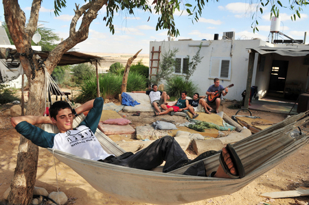 kibbutz: NITZANA - NOVEMBER 22: Israeli man having fun in a commune on November 22 2011 in kibbutz Nitzana at the Negev Desert, Israel.It is a Jewish Agency Youth Village, which is dedicated to educat new immigrants to Israel.