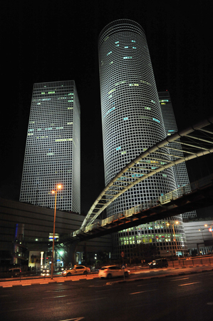 TEL AVIV - NOV 10:Azrieli Center skyscrapers at night on Nov 10 2011 in Tel Aviv, Israel.Tel Aviv has the second-largest economy in the Middle East after Dubai.