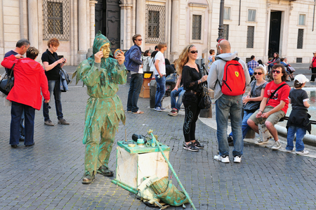 1st century: ROME - APRIL 28:Street artist in Piazza Navona on April 28 2011 in Rome, Italy.Built in 1st century AD,follows the form of a stadium and the ancient Romans came there to watch games.