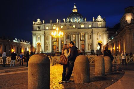 renowned: VATICAN - APR 29:Lovers kiss at Saint Peters Basilica on April 29 2011 Vatican city,Italy.Its the most renowned work of Renaissance architecture and remains one of the largest churches in the world. Editorial