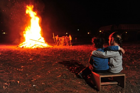 lag: Israeli youth celebrate by a bonfire the Jewish holiday of Lag Baomer, a festive day on the Jewish calendar to commemorate the death of Rabbi Shimon Bar Yochai.