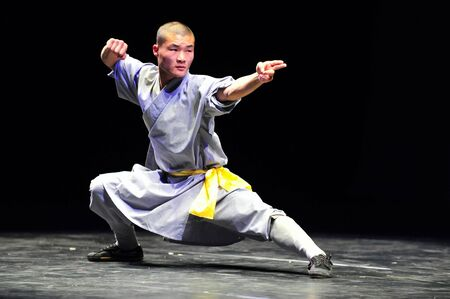 HENAN - JAN 13: Shaolin monks feature Kung Fu martial arts fight on January 13 2011 in Henan Province, China. It collection of Chinese martial arts that claim affiliation with the Shaolin Monastery.