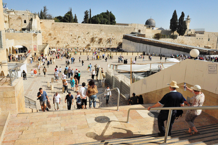 hassid: JERUSALEM - MAY 10:Visitors at the Wailing Wall on May 10 2011 in Jerusalem, Israel.Its arguably the most sacred site recognized by the Jewish faith outside of the Temple Mount itself. Editorial