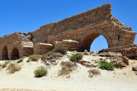 ceasarea: The ancient Roman aqueduct at Ceasarea along the coast of the Mediterranean Sea, Israel. Editorial