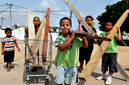 lag: ASHKELON - April 28:Israeli children collects anything made from wood that can burn before Lag BaOmer on April 28 2010 in Ashkelon,Israel. Its a festive day on the Jewish calendar to commemorate the death of Rabbi Shimon Bar Yochai. Editorial