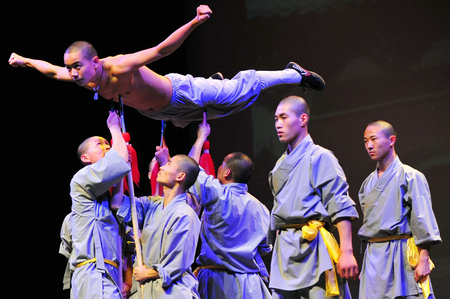 chi kung: HENAN - JAN 13: Shaolin monks feature Kung Fu martial arts fight on January 13 2011 in Henan Province, China. It collection of Chinese martial arts that claim affiliation with the Shaolin Monastery.