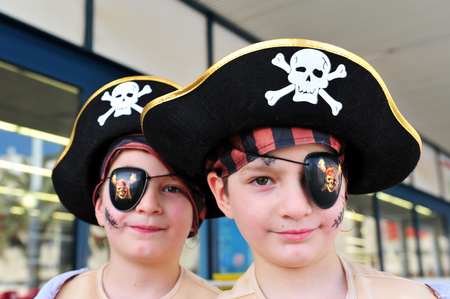 esther: SDEROT - MARCH 18: Israeli twins dressed up with pirate costume during the Jewish holiday Purim on March 18 2011 Sderot, Israel. Editorial