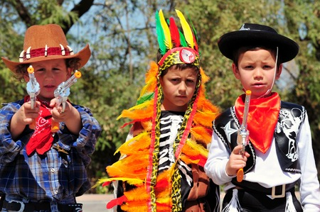 esther: ASHKELON - MARCH 18: Israeli boys dressed up with cowboys and indian costume during the Jewish holiday Purim on March 18 2011 in kindergarden in Ashkelon Israel. Editorial