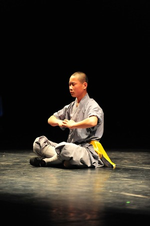 gautama buddha: HENAN - JAN 13: Shaolin monks feature Kung Fu martial arts fight on January 13 2011 in Henan Province, China. It collection of Chinese martial arts that claim affiliation with the Shaolin Monastery.