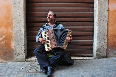 promulgated: ROME - APRIL 29:Gypsy basking with his accordion at the Jewish ghetto on April 29 2011 in Rome, Italy.The Roman Ghetto was established as a result of Papal bull promulgated by Pope Paul IV in 1555. Editorial