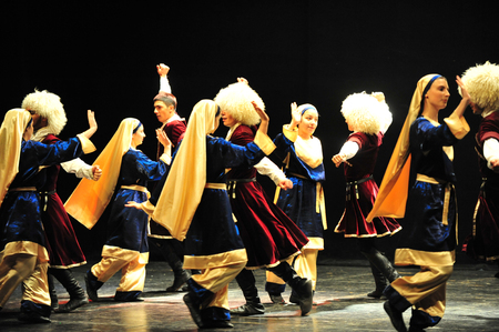 show folk: ASHDOD - MARCH 08: Georgian dancers dancing a folklore dance show on stage on March 08 2010 in Ashdod, Israel.Its a mountain dance that best representative of the Georgian people spirit.