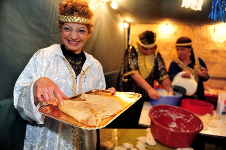 judaical: SDEROT - APRIL 05:Jewish people celebrats the traditional North African Jewish celebration Mimouna held the day after the Jewish holiday of Passover on April 05 2010 in Jerusalem, Israel. It marks the start of spring and the return to eat leavened bread a Editorial