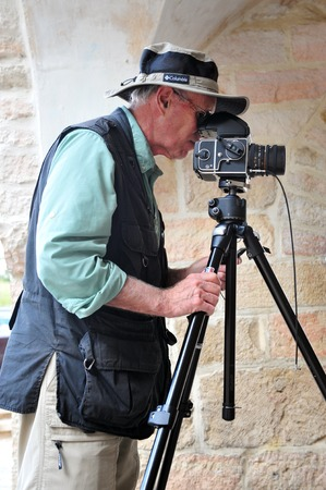 documenting: JERUSALEM - OCT 29:Travel photographer taking photos on Oct 29 2010.Most photographers are self-employed and only the most skilled and talented with good business sense maintain long-term careers.