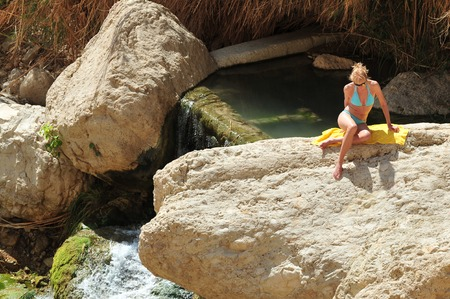 ein: EIN GEDI, ISR - MAR 18 :tourist sunbathe in Ein Gedi spring on March 18 2009. Its a very famous and popular  oasis on the shore of Israels Dead Sea, the lowest place on Earth. Editorial