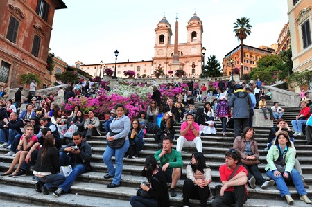 financed: ROME - APRIL 28:Visitors at the Spanish Steps on April 28 2011 in Rome, Italy.Built in 1723-1725 by a design of the architect Francesco de Sanctis and financed by French diplomat Etienne Gueffier. Editorial