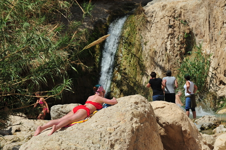 ein: EIN GEDI, ISR - MAR 18 :Visitors in Ein Gedi spring on March 18 2009. Its a very famous and popular  oasis on the shore of Israels Dead Sea, the lowest place on Earth. Editorial