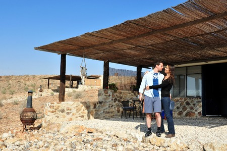 NEGEV, ISR - APR 07:Happy couple in a desert lodge on April 07 2011.The Negev covers more than half of Israel, over some 13,000 km² (4,700 sq mi) or at least 55% of the countrys land area.
