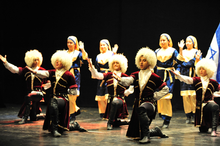 ashdod: ASHDOD - MARCH 08: Georgian dancers dancing a folklore dance show on stage on March 08 2010 in Ashdod, Israel.Its a mountain dance that best representative of the Georgian people spirit.
