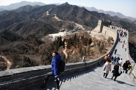 china people: BEIJING - MARCH 10:Visitors walks on the Great Wall of China on March 10 2008. The Great Wall of China is the longest man-made structure in the world. Editorial