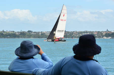 transom: AUCKLAND, NEW ZEALAND - JANUARY 31 2012: The Team New Zealand TNZ sailing team yacht who based in Auckland, New Zealand as seen from Devon Port on January 31 2012.