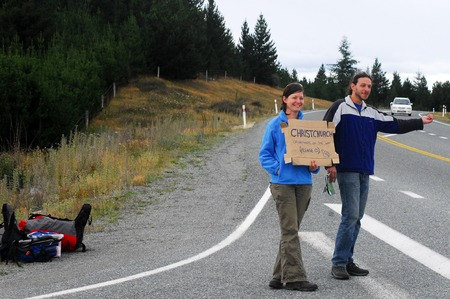 safest: LAKE TEKAPO, NZ - MARCH 01: Young couple are Hitchhiking in south island of New Zealand on March 01 2009. New Zealand is one of the safest places in the world to hitchhike. Editorial