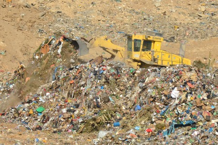 recycling center: SOUTH ISRAEL, NOVEMBER 1, 2011. A bulldozer clears garbage in a recycling center.