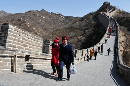 BEIJING - MARCH 10:Visitors walks on the Great Wall of China on March 10 2008. Four million people visits the great wall each year. Editöryel