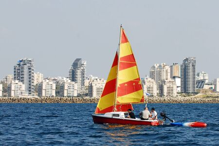 ashdod: ASHDOD, ISR - MAY 03:People enjoy sailing at the sea along Ashdod skyline on May 03 2011. Ashdod is the sixth largest city in Israel with population of over 200,000 people.