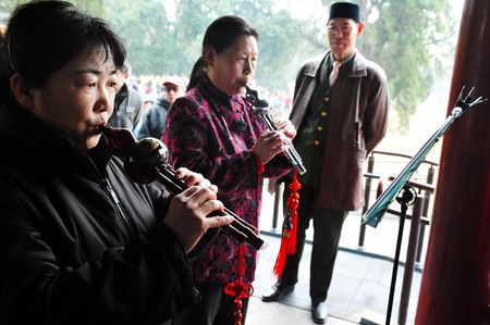 flute structure: BEIJING-MARCH 15:Chinese people play music at the temple of heaven park on Mar 15 2009 in Beijing, China.Its the most popular park in Beijing used by thousands of people for sport and leisure daily Editorial
