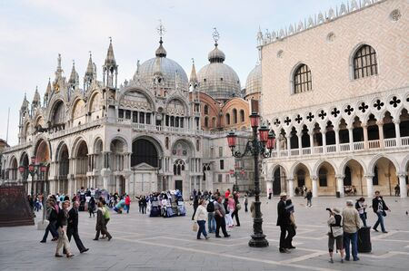 venice: The Patriarchal Cathedral Basilica of Saint Mark at the Piazza San Marco - St Marks Square , Venice Italy.