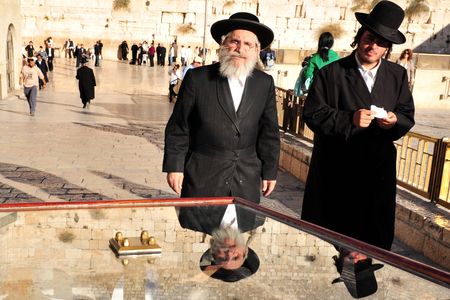 hassid: JERUSALEM - MAY 10:Jewish men at the Wailing Wall on May 10 2011 in Jerusalem, Israel.Its arguably the most sacred site recognized by the Jewish faith outside of the Temple Mount itself.