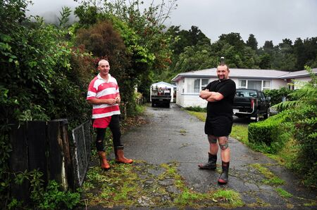 nz: GREYMOUTH,NZ - APRIL 19:Classic New Zealand men wearing gumboots and shorties on April 19 2009.The population of NZ is 4.4 million and the life expectancy of men is 76 years and 81 years for women.