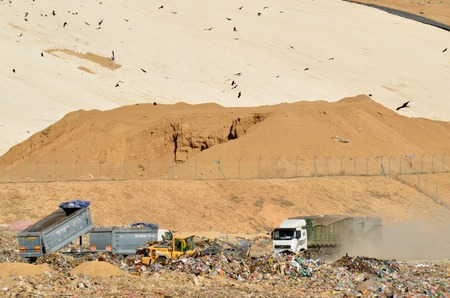 salvage yards: SOUTH ISRAEL, NOVEMBER 1, 2011. Trucks empty garbage in a recycling center.