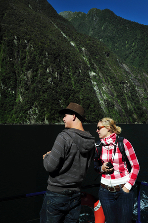 nz: FIORDLAND, NZ- FEB 28:Tourist explores Milford Sound on February 28 2009.Its one of the most  beautiful parts of New Zealand and the largest of NZ national parks with an area of 12,500 km.
