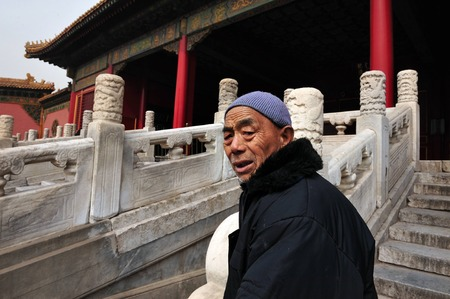 expectancy: BEIJING - MARCH 11:Chinese man at the Forbidden City on March 11 2009 in Beijing,China. The average life expectancy among Chinese men is 72 years Editorial