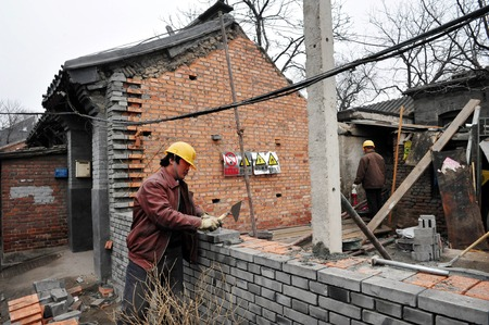11 years old: BEIJING - MARCH 11:Chinese builders are renovating an old house in a Hutong on March 11 2009 in Beijing, China.There is around 4,000 Hutongs in Beijing some are hundreds of years old Editorial