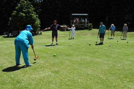 crocket: WAIHEKE, NZ - FEB 17:Elderly playing croquet on february 17 2009.Its New Zealands most densely populated island, with 83.58 peoplekm, and the third most populated after the North and South Island. Editorial