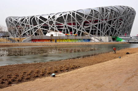 BEIJING - APRIL 04: The Birds Nest Stadium at the Olympic Green park on April 04 2009 in Beijing, China.The birds nest can withstand an earthquake of up to magnitude 8 on the Richter Scale.