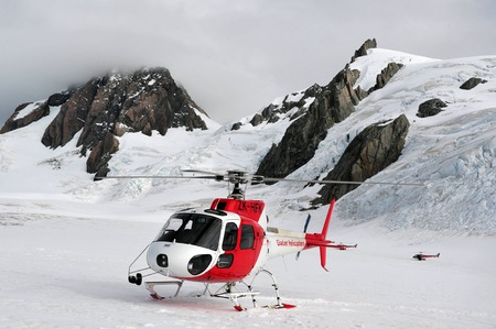 icecaps: FOX GLACIER, NZ - MAR 07:Two Helicopters on top of Fox Glacier on March 07 2009,NZ.Its  a 13 km 8.1 mi long glacier located in Westland National Park on the West Coast of New Zealands South Island
