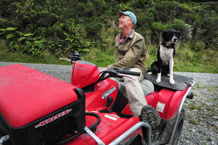 nz: WEST COAST, NZ - APRIL 19:NZ farmer and his Border Collie dog on April 19 2009.Its one of the more remote and most sparsely populated areas in NZ with only 31,326 inhabitants NZ census 2006 records