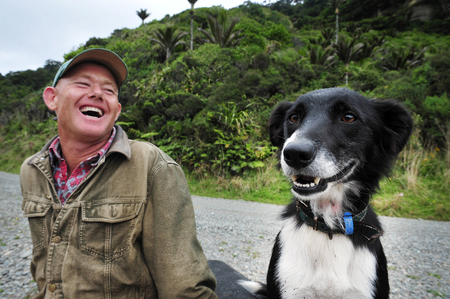 WEST COAST, NZ - APRIL 19:NZ farmer and his Border Collie dog on April 19 2009.Its one of the more remote and most sparsely populated areas in NZ with only 31,326 inhabitants NZ census 2006 records