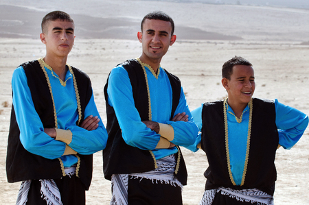 nomadic: WESTERN NEGEV-DECEMBER 13:Bedouin arab men wear traditional kufeyas dancing clothing on December 13 2011.Negev Bedouin are formerly nomadic and later also semi-nomadic Arabs who live by rearing livestock in the deserts of southern Israel.