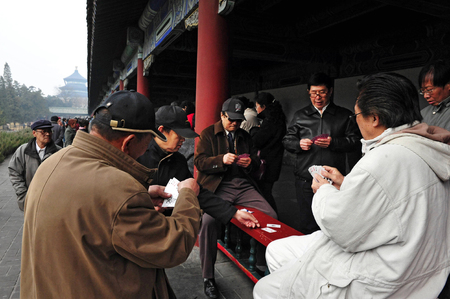 play popular: BEIJING-MARCH 15:Chinese people play cards at the Temple of Heaven park on Mar 15 2009 in Beijing, China.Its the most popular park in Beijing used by thousands of people for sport and leisure daily Editorial